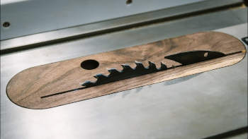 Zero clearance insert with riving knife opening
